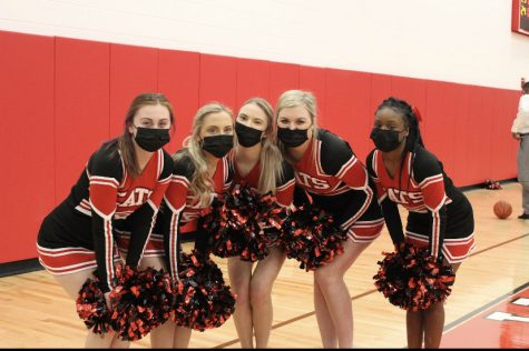 The Wildcat Senior Cheerleaders following covid protocols and wearing masks on sidelines during game against Dublin Scioto.