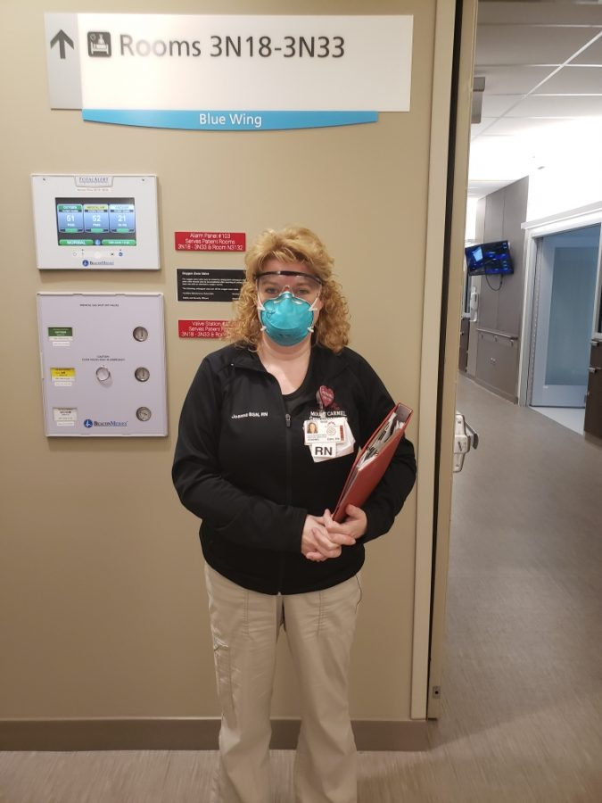 Nurse Campbell in her PPE as she prepares for her day taking care of Covid patients and preparing others for outpatient care.