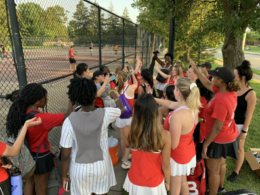 The Westerville South Girls Tennis Team celebrates their sweep against Westerville North High School after a tough competition on the second doubles court. The Wildcat Ladies played against the Warrior Ladies at Westerville South High School on Aug. 18, 2021. Mary Pedrozo (senior), Leanne Ngo (junior), and Baydan Matan (senior) took on singles. On the doubles court, Ama Asare (senior) and Kyra Lesmerises (senior) played first doubles and Nhi Ton (senior) and Claudia Stanton (junior) played second doubles. The Lady Cats won 5-0 against Westerville North.