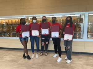 """Picture of Westerville South High School students Ama Oppong Brago, Jessica Adongo, Jada Orr, Tiara Takyi, and Diana Atieh (left to right) receiving certificates of achievements for their student-led """"Intro to Adulting"""" project on Tuesday, Aug. 24, 2021. Diana Atieh says, """"Students should take the opportunity to take this class because we do have the chance to offer it and it would be beneficial to them."""""""