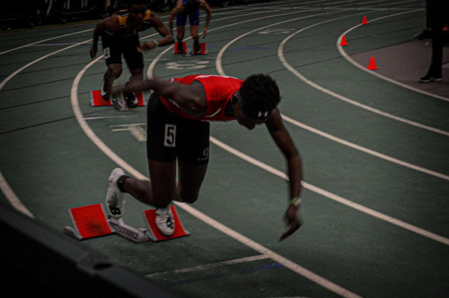 Senior, Emmanuel Asabere participating in high jump and the decathlon.